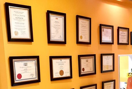 wall with lots of certificates